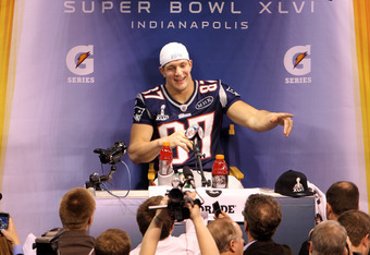 INDIANAPOLIS, IN - JANUARY 31:  Rob Gronkowski #87 of the New England Patriots answers questions from the media during Media Day ahead of Super Bowl XLVI against the New York Giants at Lucas Oil Stadium on January 31, 2012 in Indianapolis, Indiana.  (Phot