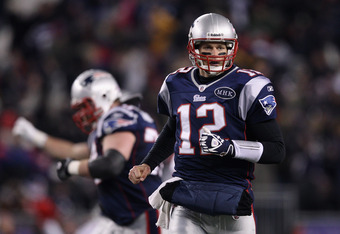 FOXBORO, MA - JANUARY 14:  Tom Brady #12 of the New England Patriots reacts after he threw a 61-yard touchdown pass to Deion Branch #84 in the second quarter against the Denver Broncos during their AFC Divisional Playoff Game at Gillette Stadium on Januar