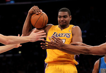 LOS ANGELES, CA - JANUARY 16:   Andrew Bynum #17 of the Los Angeles Lakers  fights for a loose ball against the Dallas Mavericks at Staples Center on January 16, 2012 in Los Angeles, California.  NOTE TO USER: User expressly acknowledges and agrees that,