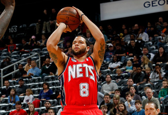 ATLANTA, GA - DECEMBER 30:  Deron Williams #8 of the New Jersey Nets against the Atlanta Hawks at Philips Arena on December 30, 2011 in Atlanta, Georgia.  NOTE TO USER: User expressly acknowledges and agrees that, by downloading and or using this photogra