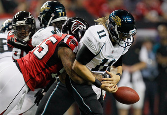 ATLANTA, GA - DECEMBER 15:  John Abraham #55 of the Atlanta Falcons forces a fumble as he sacks Blaine Gabbert #11 of the Jacksonville Jaguars in the first half at the Georgia Dome on December 15, 2011 in Atlanta, Georgia.  (Photo by Kevin C. Cox/Getty Im