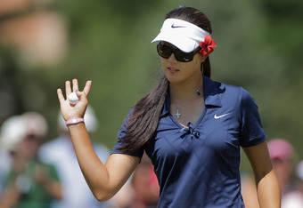 COLORADO SPRINGS, CO - JULY 07:  Michelle Wie gestures to the gallery after sinking a putt for birdie on the first hole during the first round of the U.S. Women's Open at The Broadmoor on July 7, 2011 in Colorado Springs, Colorado.  (Photo by Doug Pensing