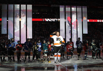 OTTAWA, ON - JANUARY 28:  Scott Hartnell #19 0f the Philadelphia Flyers and team Alfredsson salutes as he is introduced to the 2012 Molson Canadian NHL All-Star Skills Competition at Scotiabank Place on January 28, 2012 in Ottawa, Ontario, Canada.  (Photo