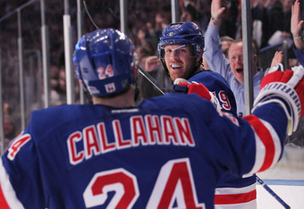 NEW YORK, NY - NOVEMBER 29:  Brad Richards #19 of the New York Rangers celebrates his second period goal with teammate Ryan Callahan #24 against the Pittsburgh Penguins at Madison Square Garden on November 29, 2011 in New York City.  (Photo by Nick Laham/