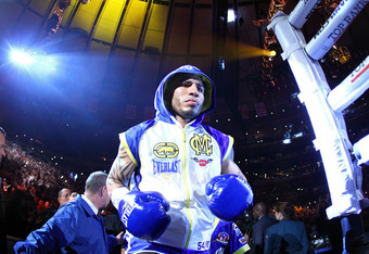 NEW YORK, NY - DECEMBER 03:  Miguel Cotto of Puerto Rico enters the ring before fighting against Antonio Margarito of Mexico during the WBA World Junior Middleweight Title fight at Madison Square Garden on December 3, 2011 in New York City.  (Photo by Al