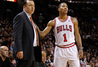 MIAMI, FL - JANUARY 29: Derrick Rose #1 of the Chicago Bulls talks with head coach Tom Thibodeau during a game  at American Airlines Arena on January 29, 2012 in Miami, Florida. NOTE TO USER: User expressly acknowledges and agrees that, by downloading and