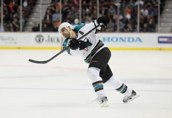 ANAHEIM, CA - JANUARY 04:  Dan Boyle #22 of the San Jose Sharks takes a shot against the Anaheim Ducks at Honda Center on January 4, 2012 in Anaheim, California.  (Photo by Jeff Gross/Getty Images)