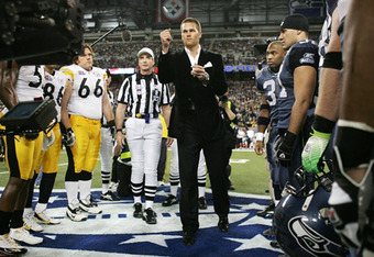 Tom Brady served as the honorary coin-flipper for Super Bowl XL, which may give New England invaluable insight into which side the Giants may call. (Harry How/Getty Images)