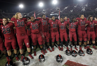 STANFORD, CA - NOVEMBER 26:  Players for the Stanford Cardinal celebrate after beating the Notre Dame Fighting Irish at Stanford Stadium on November 26, 2011 in Stanford, California.  (Photo by Ezra Shaw/Getty Images)