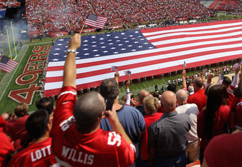 SAN FRANCISCO, CA - SEPTEMBER 11:  A giant American flag is spread across the field during the singing of the National Anthem before the San Francisco 49ers' season opener against the Seattle Seahawks at Candlestick Park on September 11, 2011 in San Franc