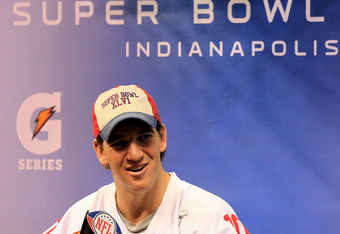 INDIANAPOLIS, IN - JANUARY 31:  Quarterback Eli Manning #10 of the New York Giants answers question from the media during Media Day ahead of Super Bowl XLVI against the New England Patriots at Lucas Oil Stadium on January 31, 2012 in Indianapolis, Indiana