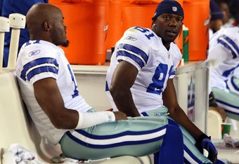 PHILADELPHIA - DECEMBER 28:  Roy Williams #11 and Terrell Owens #81 of the Dallas Cowboys sit on the bench late in the game against the Philadelphia Eagles on December 28, 2008 at Lincoln Financial Field in Philadelphia, Pennsylvania. The Eagles defeated