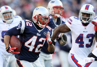 FOXBORO, MA - JANUARY 01:  BenJarvus Green-Ellis #42 of the New England Patriots carries the ball for 53 yards against the Buffalo Bills on January 1, 2012 at Gillette Stadium in Foxboro, Massachusetts.  (Photo by Elsa/Getty Images)