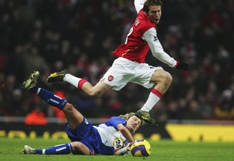 LONDON - DECEMBER 23:  Alexander Hleb of Arsenal takes on Robbie Savage of Blackburn Rovers during the Barclays Premiership match between Arsenal and Blackburn Rovers at the Emirates Stadium on December 23, 2006 in London, England.  (Photo by Phil Cole/Ge