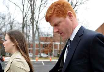 STATE COLLEGE, PA - JANUARY 24: Former Penn State assistant coach Mike McQueary walks outside after paying respect to former Penn State Football coach Joe Paterno during a public viewing at the Pasquerilla Spiritual Center on the campus of Penn State on J
