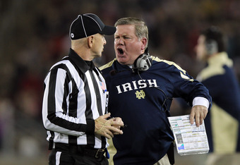 STANFORD, CA - NOVEMBER 26: Notre Dame Fighting Irish head coach Brian Kelly argues a call with side judge Glenn Crowther during their game against the Stanford Cardinal at Stanford Stadium on November 26, 2011 in Stanford, California.  (Photo by Ezra Sha