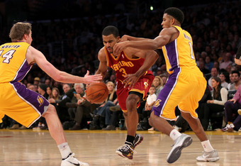 LOS ANGELES, CA - JANUARY 13: Ramon Sessions #3 of the Cleveland Cavaliers drives between Darius Morris #1 and Troy Murphy #14 of the Los Angeles Lakers at Staples Center on January 13, 2012 in Los Angeles, California.  The Lakers won 97-92. NOTE TO USER:
