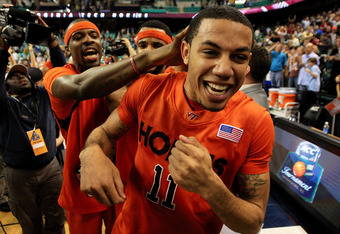 GREENSBORO, NC - MARCH 11:  Erick Green #11, Malcolm Delaney #23 and Paul Debnam #32 of the Virginia Tech Hokies celebrate their 52-51 win over the Florida State Seminoles during the second half in the quarterfinals of the 2011 ACC men's basketball tourna