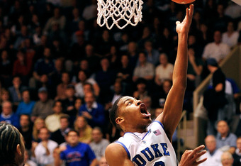 DURHAM, NC - JANUARY 12:  Quinn Cook #2 of the Duke Blue Devils scores as he drives against Mike Scott #23 of the Virginia Cavaliers during play at Cameron Indoor Stadium on January 12, 2012 in Durham, North Carolina.  (Photo by Grant Halverson/Getty Imag