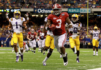 NEW ORLEANS, LA - JANUARY 09:  Trent Richardson #3 of the Alabama Crimson Tide runs for a 34 yard touchdown in the fourth quarter against Morris Claiborne #17 of the Louisiana State University Tigers during the 2012 Allstate BCS National Championship Game