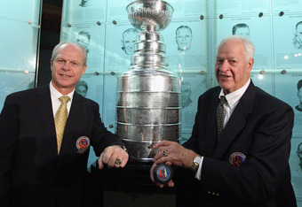 TORONTO, ON - NOVEMBER 14:  (L-R) 2011 Hall of Fame inductee Mark Howe poses along with his father Gordie Howe during a photo opportunity at the Hockey Hall Of Fame on November 14, 2011 in Toronto, Ontario, Canada.  (Photo by Bruce Bennett/Getty Images)