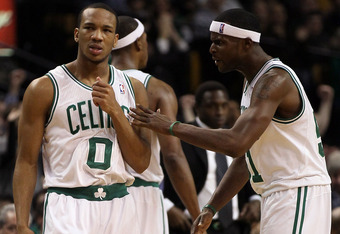 BOSTON, MA - JANUARY 04:  Avery Bradley #0 is congratulated by teammate Keyon Dooling #51 of the Boston Celtics after Bradley stole the ball from Jordan Farmar of the New Jersey Nets on January 4, 2012 at TD Garden in Boston, Massachusetts. The Boston Cel