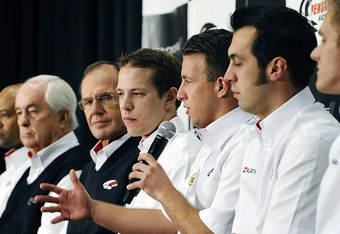 CONCORD, NC - JANUARY 26:  A.J. Allmendinger, driver of the #22 Shell/Pennzoil Dodge, speaks with the media during the 2012 NASCAR Sprint Cup Series Media Tour hosted by Charlotte Motor Speedway on January 26, 2012 in Concord, North Carolina.  (Photo by J