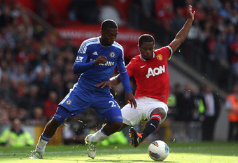 MANCHESTER, ENGLAND - SEPTEMBER 18:  Patrice Evra of Manchester United competes with Daniel Sturridge of Chelsea during the Barclays Premier League match between Manchester United and Chelsea at Old Trafford on September 18, 2011 in Manchester, England.