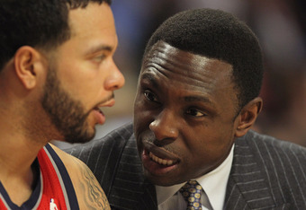 CHICAGO, IL - JANUARY 23:  Head coach Avery Johnson of the New Jersey Nets talks with Deron Williams #8 on the bench during a game against the Chicago Bulls at the United Center on January 23, 2012 in Chicago, Illinois. The Bulls defeated the Nets 110-95.