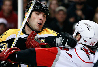 Zdeno Chara's temper with Jay Harrison boils over in an early game with the Hurricanes