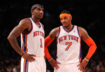 NEW YORK, NY - DECEMBER 21:  Amare Stoudemire #1 , and Carmelo Anthony #7 of the New York Knicks talk during their pre season game  against the New Jersey Nets at Madison Square Garden on December 21, 2011 in New York City. NOTE TO USER: User expressly ac
