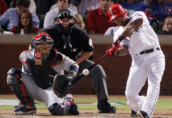 ARLINGTON, TX - OCTOBER 24:  Adrian Beltre #29 of the Texas Rangers hits a solo home run in the sixth inning during Game Five of the MLB World Series against the St. Louis Cardinals at Rangers Ballpark in Arlington on October 24, 2011 in Arlington, Texas.