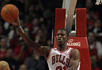 CHICAGO, IL - JANUARY 27: Jimmy Butler #21 of the Chicago Bulls passes the ball after grabbing a rebound against the Milwaukee Bucks at the United Center on January 27, 2012 in Chicago, Illinois. NOTE TO USER: User expressly acknowledges and agrees that,