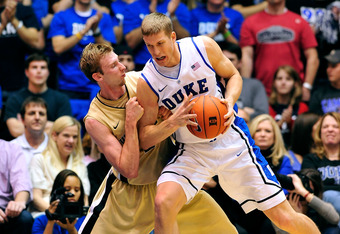 DURHAM, NC - JANUARY 19:  Mason Plumlee #5 of the Duke Blue Devils backs down Nikita Mescheriakov #25 of the Wake Forest Demon Deacons during play at Cameron Indoor Stadium on January 19, 2012 in Durham, North Carolina. Duke won 91-73.  (Photo by Grant Ha