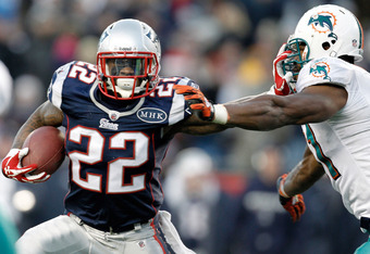 FOXBORO, MA - DECEMBER 24:  Stevan Ridley #22 of the New England Patriots stiff arms Cameron Wake #91 of the Miami Dolphins during the fourth quarter of New England's 27-24 win at Gillette Stadium on December 24, 2011 in Foxboro, Massachusetts.  (Photo by