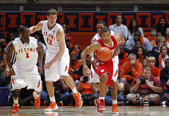 CHAMPAIGN, IL - JANUARY 22: Jordan Taylor #11 of the Wisconsin Badgers gets fouled while bringing the ball up court against the Illinois Fighting Illini during the game at Assembly Hall on January 22, 2012 in Champaign, Illinois. Wisconsin won 67-63. (Pho