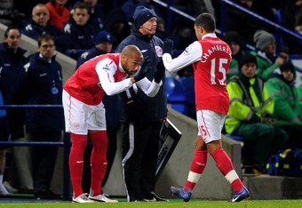 BOLTON, ENGLAND - FEBRUARY 01:  Alex Oxlade-Chamberlain of Arsenal is replaced by Thierry Henry during the Barclays Premier League match between Bolton Wanderers and Arsenal at the Reebok Stadium on February 1, 2012 in Bolton, England.  (Photo by Laurence
