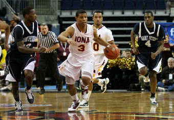 BRIDGEPORT, CT - MARCH 07:  Scott Machado #3 of the Iona Gaels pushes the ball up court against the St. Peter's Peacocks during the final of the MAAC men's conference basketball tournment at Webster Bank Arena at Harbor Yard on March 7, 2011 in Bridgeport