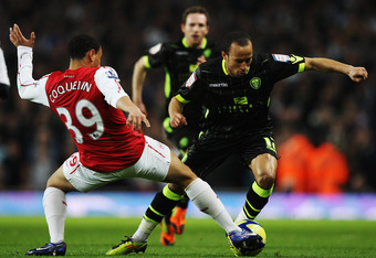 LONDON, ENGLAND - JANUARY 09:  Andros Townsend (R) of Leeds United and Francis Coquelin (L) of Arsenal challenge for the ball during the FA Cup Third Round match between Arsenal and Leeds United at the Emirates Stadium on January 9, 2012 in London, Englan