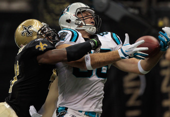 NEW ORLEANS, LA - JANUARY 01:   Roman Harper #41 of the New Orleans Saints breaks up a pass intended for  Greg Olsen #88 of the Carolina Panthers at the Mercedes-Benz Superdome on January 1, 2012 in New Orleans, Louisiana.  (Photo by Chris Graythen/Getty