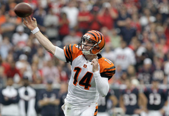 HOUSTON, TX - JANUARY 07:  Andy Dalton #14 of the Cincinnati Bengals throws a pass in the first half against the Houston Texans during their 2012 AFC Wild Card Playoff game at Reliant Stadium on January 7, 2012 in Houston, Texas.  (Photo by Thomas B. Shea