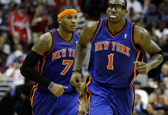 WASHINGTON, DC - JANUARY 06: Carmelo Anthony #7 and Amare Stoudemire #1 of the New York Knicks run up the court against the Washington Wizards at Verizon Center on January 6, 2012 in Washington, DC.  NOTE TO USER: User expressly acknowledges and agrees th
