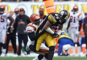 07 Oct 2001:  Tom Carter #21 of the Cincinnati Bengals is being dragged by Hines Ward #86 of the Pittsburgh Steelers during the game at Heinz Stadium in Pittsburgh, Pennsylvania. The Steelers won 16-7. DIGITAL IMAGE. Mandatory Credit: Jason Cohn/Allsport