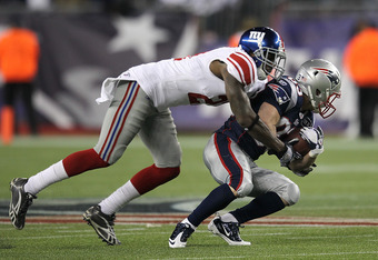 FOXBORO, MA - NOVEMBER 6:   Kenny Phillips #21 of the New York Giants stops  Wes Welker #83 of the New England Patriots on November 6, 2011 in Foxboro, Massachusetts. The Giants won 24-20. (Photo by Jim Rogash/Getty Images)
