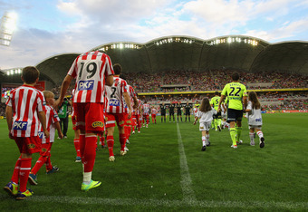 MELBOURNE, AUSTRALIA - FEBRUARY 04: The teams walk out prior to the start of the round 18 A-League match between the Melbourne Heart and the Melbourne Victory at AAMI Park on February 4, 2012 in Melbourne, Australia.  (Photo by Robert Cianflone/Getty Imag
