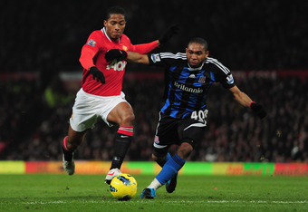 MANCHESTER, ENGLAND - JANUARY 31:  Wilson Palacios of Stoke City battles with Antonio Valencia of Manchester United during the Barclays Premier League match between Manchester United and Stoke City at Old Trafford on January 31, 2012 in Manchester, Englan
