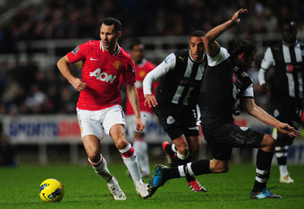 NEWCASTLE UPON TYNE, ENGLAND - JANUARY 04:  Man United forward Ryan Giggs in action during the Barclays Premier league game between Newcastle United and Manchester United at St James' Park on January 4, 2012 in Newcastle upon Tyne, England.  (Photo by Stu