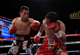 NEW YORK - OCTOBER 22:  Nonito Donaire of the Philippines connects with a left to Omar Narvaez of Argentina in the WBC, WBO World Bantamweight Titles bout at Madison Square Garden on October 22, 2011 in New York City.  (Photo by Chris Trotman/Getty Images