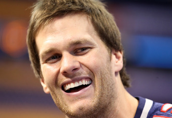 INDIANAPOLIS, IN - JANUARY 31:  Tom Brady #12 of the New England Patriotsanswers questions from the media during Media Day ahead of Super Bowl XLVI against the New York Giants at Lucas Oil Stadium on January 31, 2012 in Indianapolis, Indiana.  (Photo by A