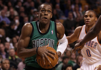 BOSTON, MA - JANUARY 16:  Rajon Rondo #9 of the Boston Celtics heads for the net as Russell Westbrook #0 of the Oklahoma City Thunder defends on January 16, 2012 at TD Garden in Boston, Massachusetts. NOTE TO USER: User expressly acknowledges and agrees t
